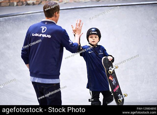 Tony Hawk (Laureus Academy Member) claps with a child of the project. Laureus Sport for Good Skateboarding Event. GES / Laureus World Sports Awards 2020, Berlin