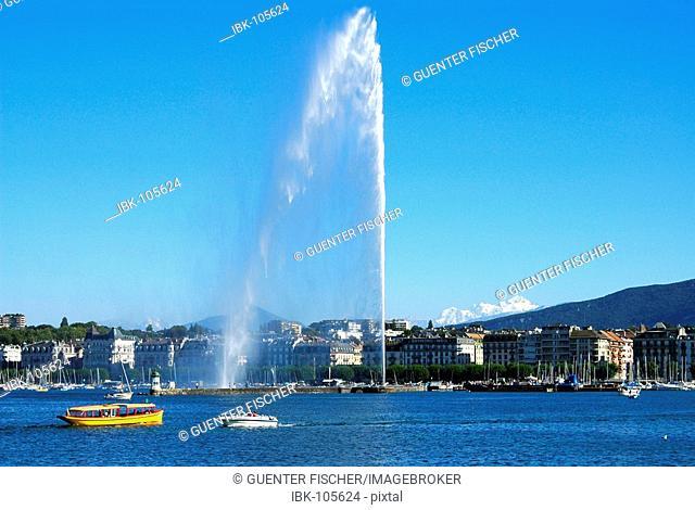 Lakefront La Rade giant fountain Jet d'eau and Mont Blanc mountians Geneva Switzerland