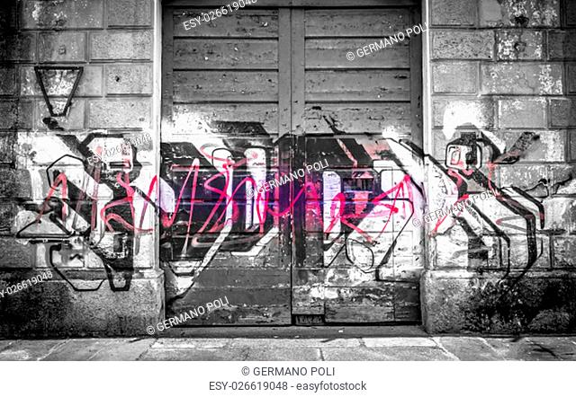 Abandoned building covered with graffiti. The power of color