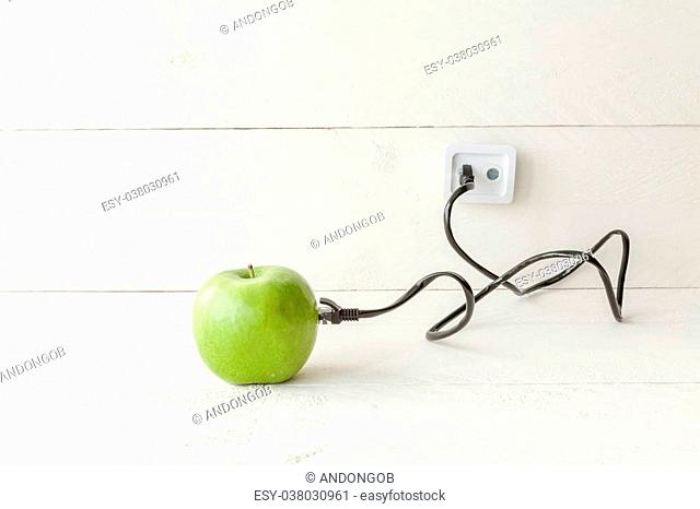 The picture shows an apple connected to an ethernet cable conceptualizing the internet of things and wearables