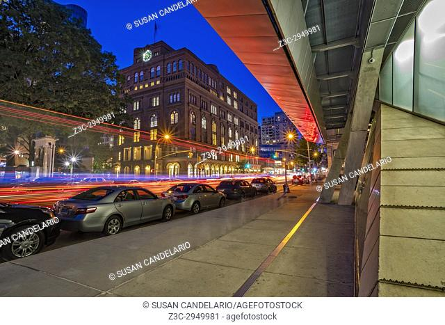 Cooper Union NYC - View of the new and modern building framing The Cooper Union College during the blue hour. In contrast to the original building