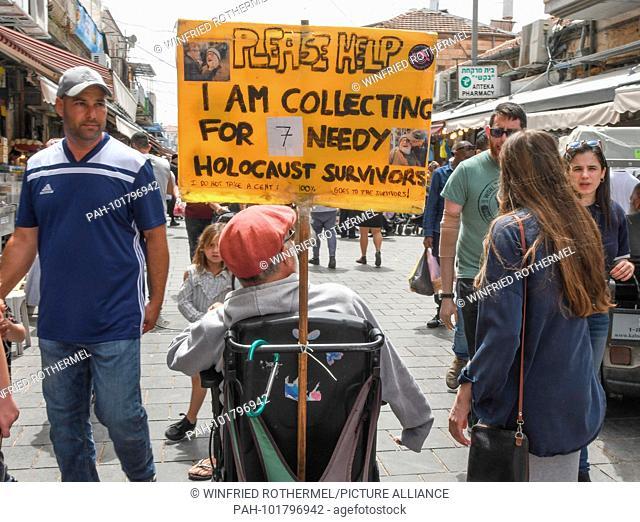 collecting for holocaust-survivors, Machane-Jehuda-market April 5, 2018 | usage worldwide. - Jerusalem/Israel