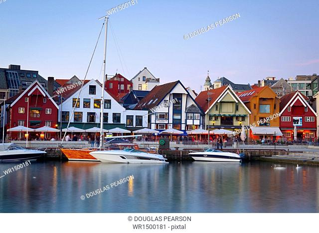 Stavanger's picturesque harbor illuminated at dusk, Stavanger, Rogaland, Norway, Scandinavia, Europe