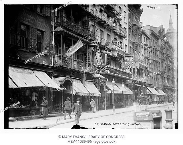 Mott Street in Chinatown, New York City. The Church of the Transfiguration, appears in the background (25 Mott Street) and the Port Arthur restaurant was at 7-9...