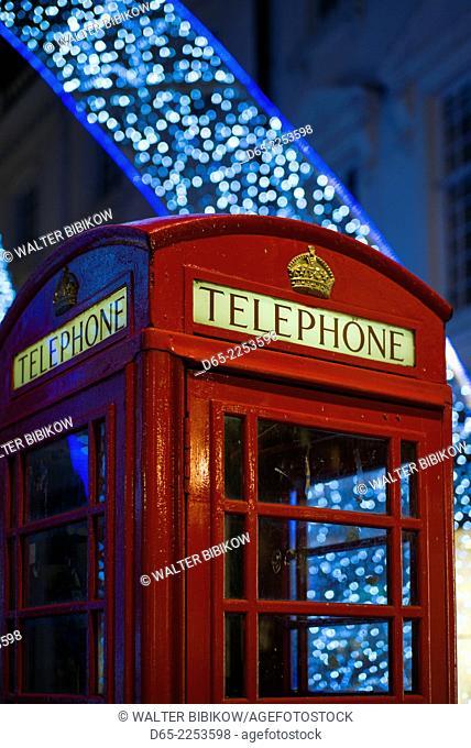 England, London, Soho, English telephone box and Christmas decorations