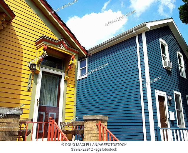 Yellow and blue painted, wood framed houses in Corktown, site of the original European settlement located in the west part of downtown Detroit, Michigan