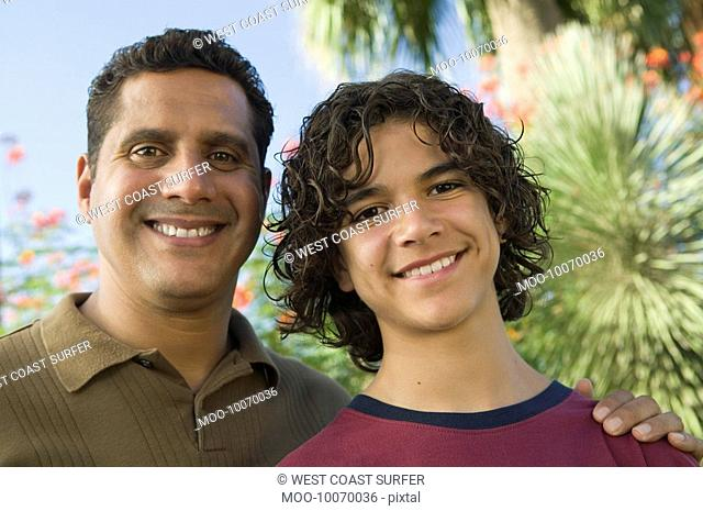 Father with Arm Around Son 13-15 front view portrait