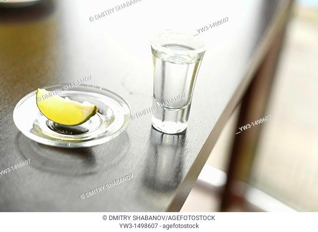 Shooter glass with tequila lime and salt