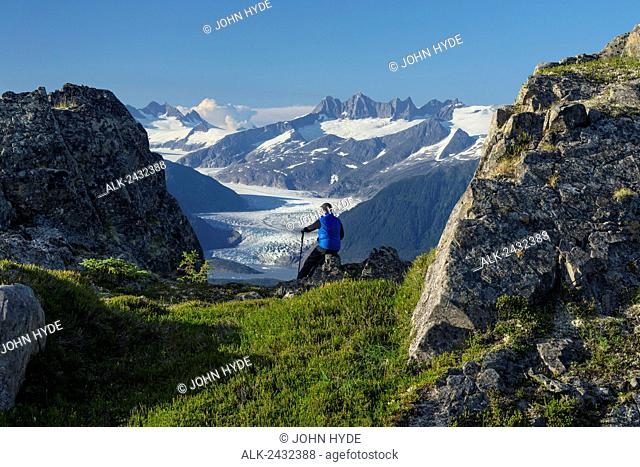 Mendenhall Glacier and the surrounding mountains provide a view for hiker on Douglas Island in Tongass National Forest, Juneau, Alaska