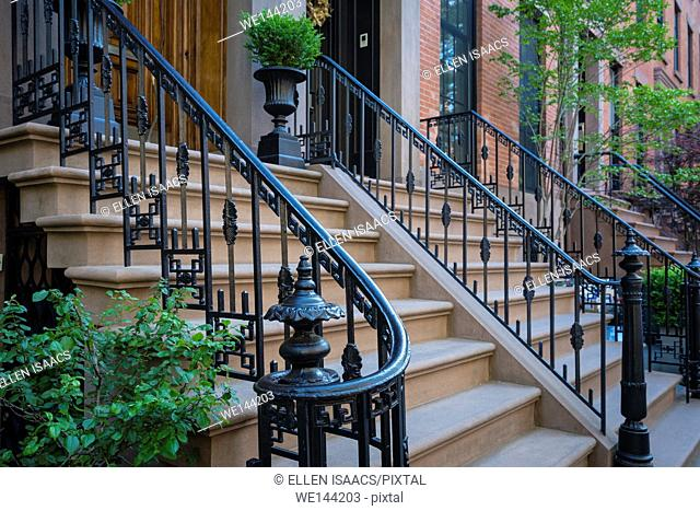 Wrought iron railings with geometric design along steps to houses in Brooklyn Heights , New York