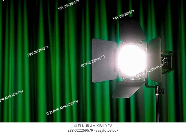 Curtains and projector lights wtih space for your text