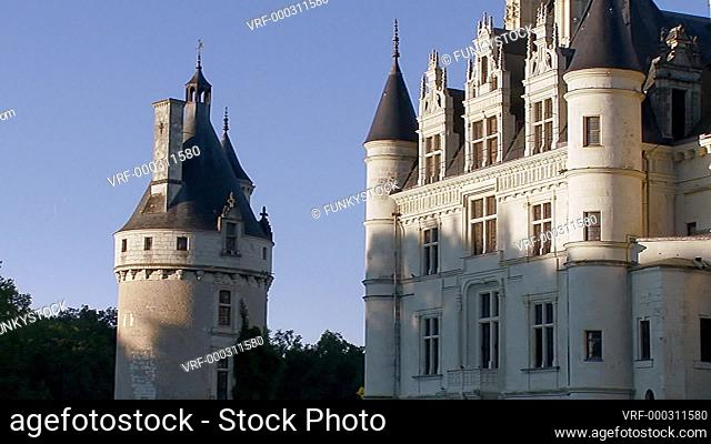 Zoom out from close up at sunset from The French Château de Chenonceau spanning the River Cher in early morning sun, Chenonceaux, Indre-et-Loire, Loire Valley