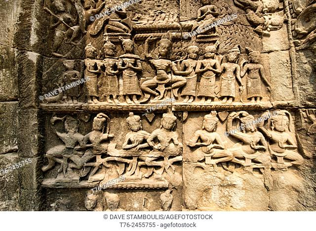bas relief carvings at Ta Phrom temple at Angkor Wat in Siem Reap, Cambodia