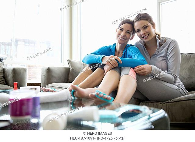 Portrait of mother and daughter doing pedicures