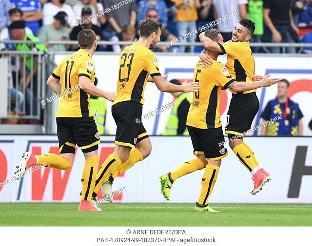 Dresden's Haris Duljevic (L-R), Florian Ballas, scorer Manuel Konrad and Aias Aosman cheer over the 2-1 score during the German 2