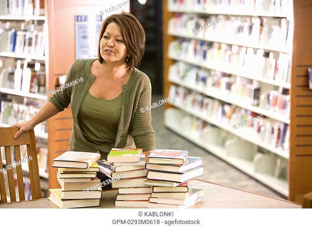 High school teacher in library