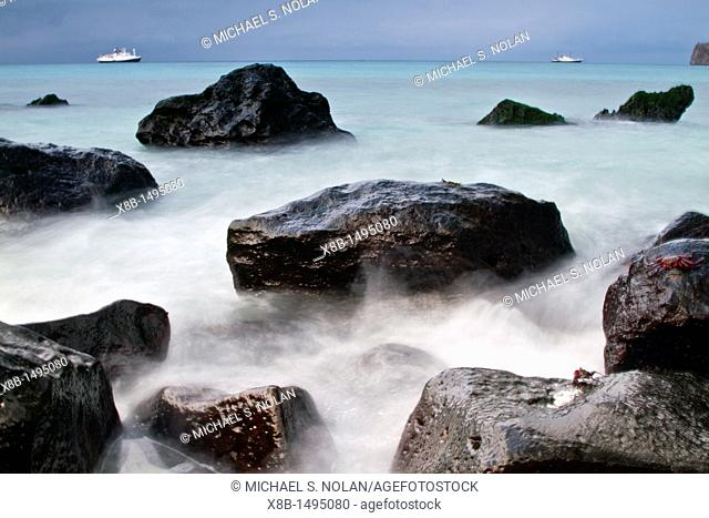 Surf breaking on lava shoreline at Gardner Bay on Espanola Island in the Galapagos Island Archipelago, Ecuador MORE INFO Slow shutter speeds allow for surreal...