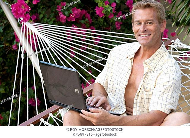 Man in hammock with laptop