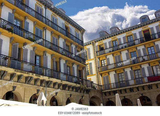 colorful and with many bows the Plaza de la Constitucion, San Sebastian, Spain
