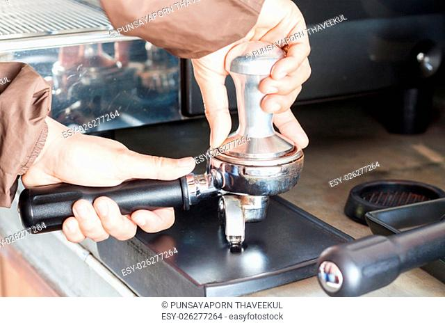 Barista with tamper for making espresso, stock photo