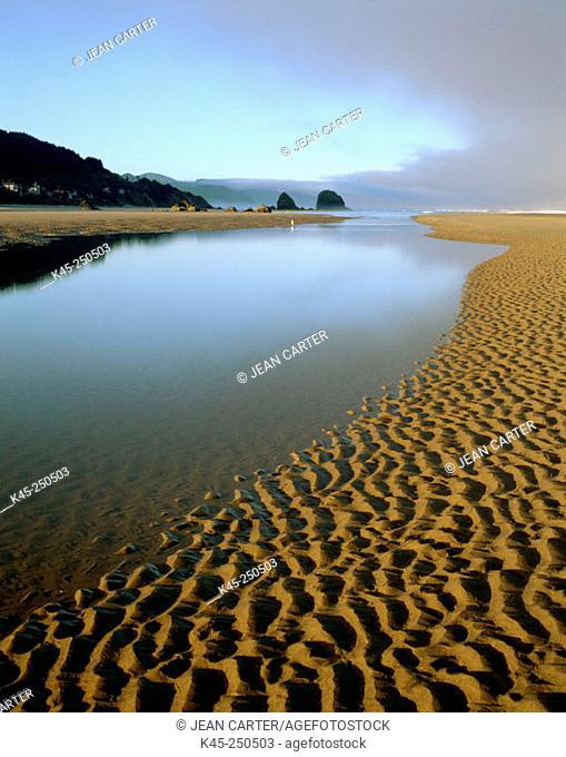 Ecola creek flows into Pacific Ocean at Cannon Beach, Northern Oregon Coast, USA