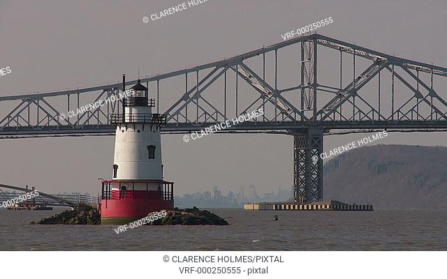 The Tarrytown Lighthouse in front of the Tappan Zee Bridge, carrying traffic over the Hudson River from Westchester County to Rockland County, New York
