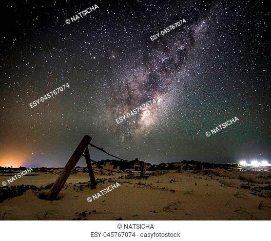 milky way galaxy in the starry night in sanddune