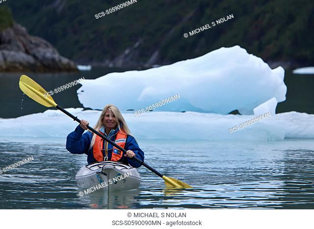 Staff member CT Ticknor from the Lindblad Expeditions ship National Geographic Sea Bird kayaking in Southeast Alaska, USA No model or property releases...