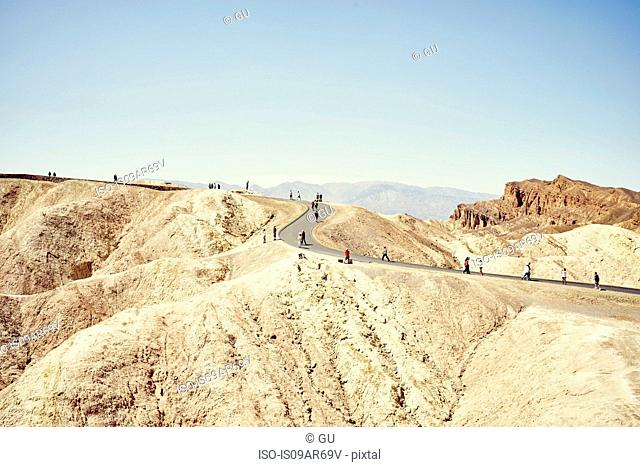 View of tourists on winding road, Zabriskie Point, Death Valley, California, USA