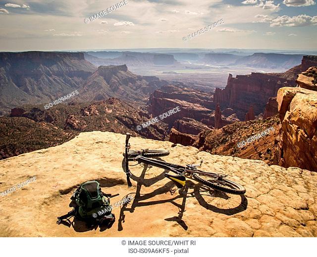 Dirt bike sitting on rocky overlook