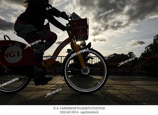 Turku, Finland Bicyclists crossing a pedestrian bridge over the Aula river