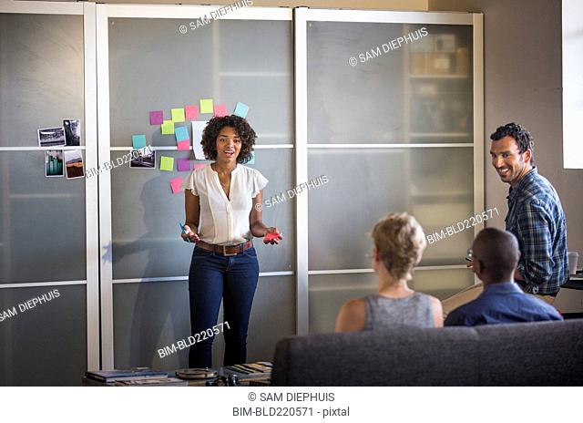 Businesswoman talking to colleagues in office meeting