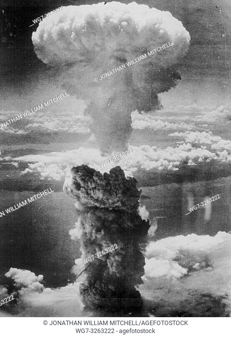 JAPAN Nagasaki -- 08 Aug 1945 -- Out with a bang. . . A dense column of smoke rises more than 60,000 feet into the air over the Japanese port of Nagasaki