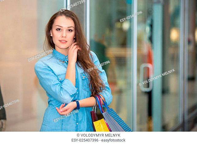 sale concept. woman with a shopping bags in the mall