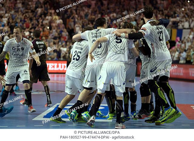 27 May 2018, Germany, Cologne: Handball: Champions League, HBC Nantes vs Montpellier HB, Final Four, Finale at Lanxess Arena: Montpellier's players celebrate...