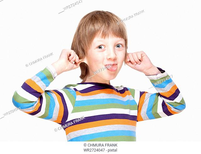 Boy Pulling his Ears and Sticking out Tongue - Isolated on White