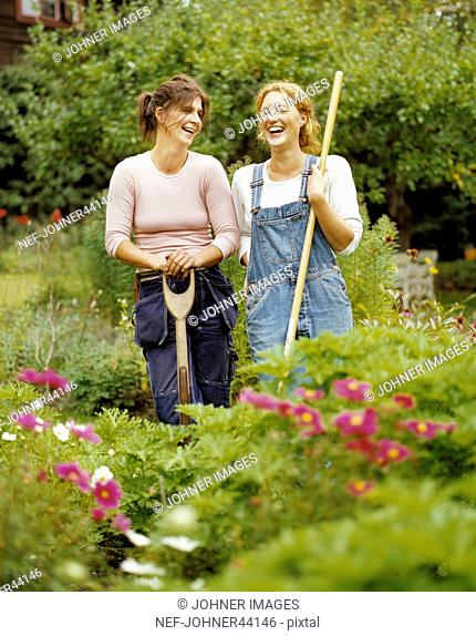 Women standing in the garden laughing