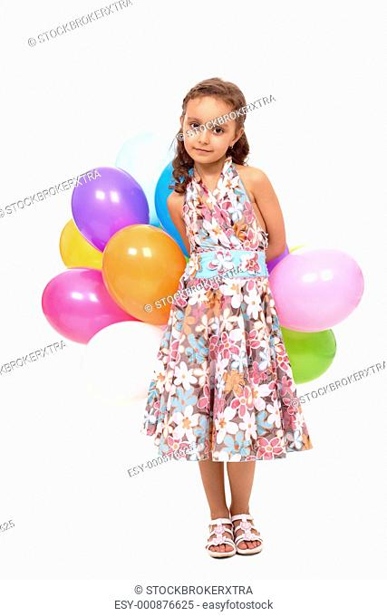 Portrait of happy girl with colorful balloons looking at camera