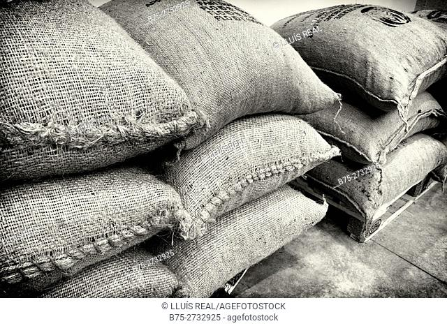 Close-up of stacked coffee bags