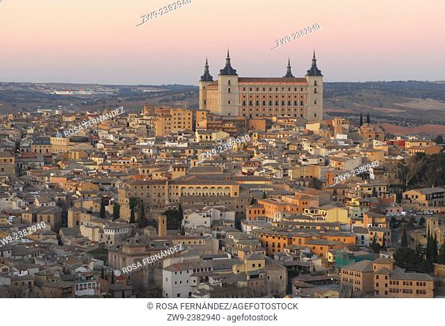 General view of the Historical center, old town of Toledo with El Alcazar, at sunset, Castilla La Mancha, Spain