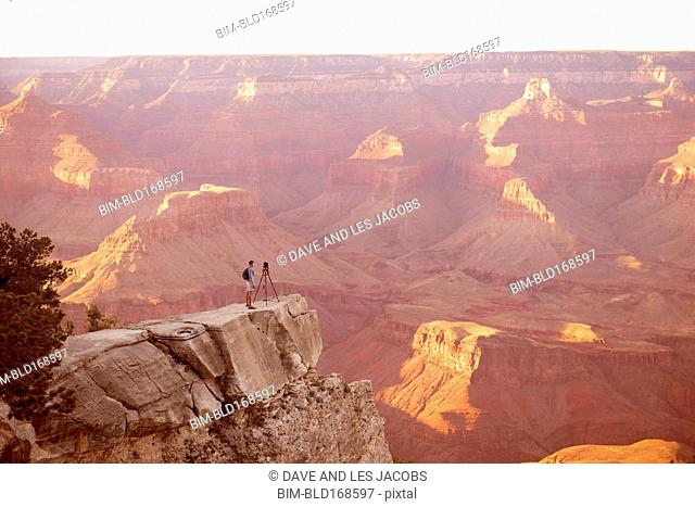Caucasian man photographing Grand Canyon, Arizona, United States
