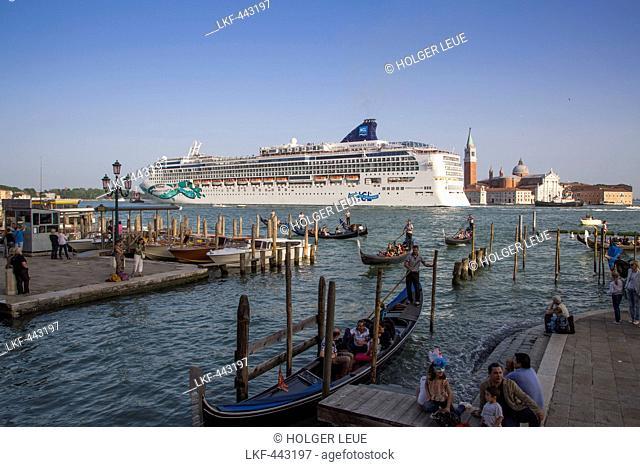 Gondolas and cruise ship Norwegian Jade (Norwegian Cruise Line) in Bacino di San Marco with Isola di San Maggiore island in distance, Venice, Veneto, Italy