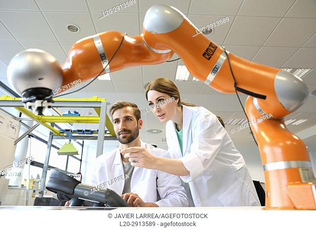 Collaborative robot for industrial assembly, LWR robot, using haptic teleoperation with force feedback Safety in human-robot cooperation, Industry