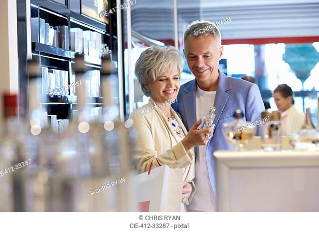 Couple shopping for perfume and cologne in shop