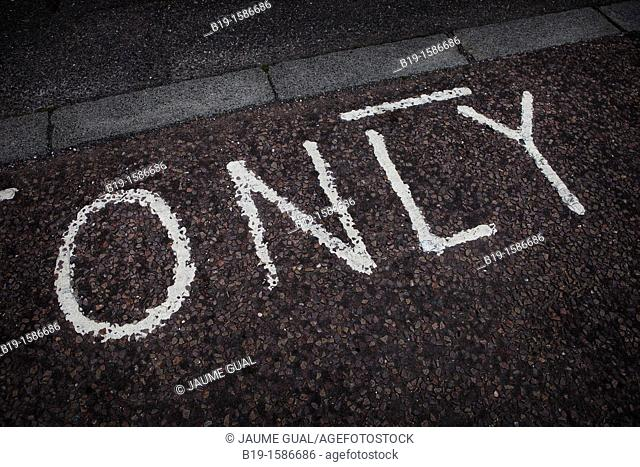 Word painted on the asphalt  Only