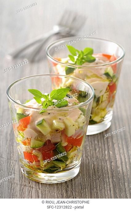 Tomato espuma with vegetables in a glass