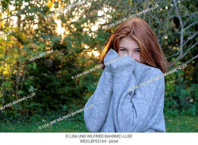Portrait of teenage girl wearing grey pullover in autumn