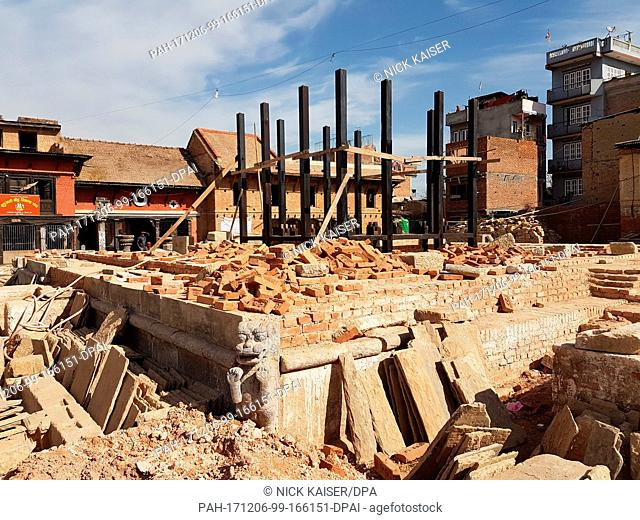 The ruins of a temple are now a building site in Bungamati, a suburb of Kathmandu, Nepal, 05 December 2017. The reconstruction progresses slowly in the...