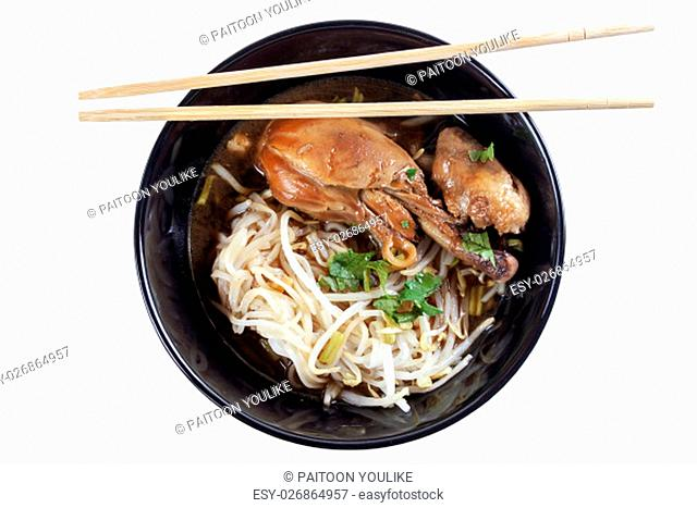 Noodle with chicken in black bowl. Isolated on white with clipping path
