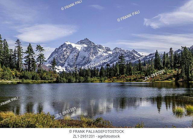 WASHINGTON - Mount Shuksan reflecting in Picture Lake in Heather Meadows Recreation Area in the North Cascades. Fall colours are abundant in the vegetation